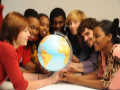 Polish and foreign IFE students gathered around a globe